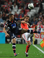 20120331: LISBON, PORTUGAL – Portuguese Liga Zon Sagres 2011/2012 - SL Benfica vs CS Braga.<br />In picture: Benfica's Miguel Vitor, right, fights for the ball with Braga's Lima, from Brazil.<br />PHOTO: Alvaro Isidoro/CITYFILES