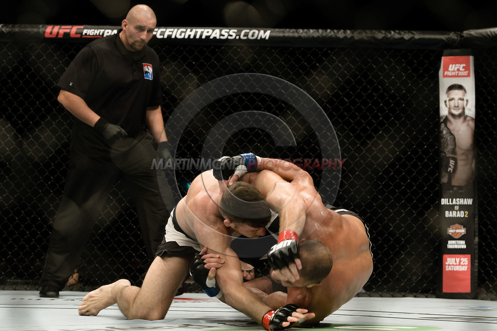 """GLASGOW, SCOTLAND, JULY 18, 2015: Michael Bisping (black shorts with white stripe) defeats Thales Leites by split decision during """"UFC Fight Night 72: Bisping vs. Leites"""" inside the SSE Hydro Arena in Glasgow, Scotland (Martin McNeil for ESPN)"""