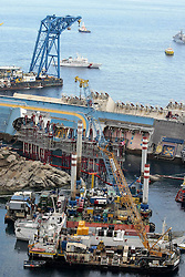 60482719 Isola del Giglio, Italy. Work begins today to right the stricken Costa Concordia vessel, which sank on January 12, 2012. If the operation is successful, it will then be towed away and scrapped. The procedure, known as parbuckling, has never been carried out on a vessel as large as Costa Concordia before, Italy, Monday September 16, 2013.<br /> Picture by imago / i-Images<br /> UK ONLY