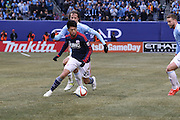 5/22/15- NYCFC midfielder M. Diskerud chases a New England Revolution forward during a NYCFC home match played at Yankee Stadium in the south Bronx.