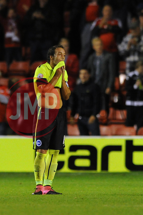 Inigo Calderon of Brighton & Hove Albion cuts a dejected figure as they lose 2-1 to Walsall in the Capital One Cup - Mandatory byline: Dougie Allward/JMP - 07966386802 - 25/08/2015 - FOOTBALL - Bescot Stadium -Walsall,England - Walsall v Brighton - Capital One Cup - Second Round