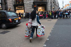 © Licensed to London News Pictures./14/2013. London, UK. Christmas shoppers walk on Regent Street during the Christmas shopping season.Photo credit : Peter Kollanyi/LNP