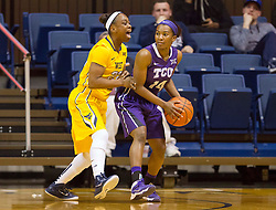 West Virginia Mountaineers guard Linda Stepney (22) plays defense on TCU Horned Frogs guard Zahna Medley (14) at the WVU Coliseum.