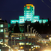 Canada, British Columbia, Vancouver, Colorfully lit City Hall overlooks Cambie Street on summer evening