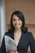 Female estate agent holding brochure smiling portrait