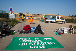Environmental activists from HS2 Rebellion use lock-on arm tubes to block a gate to the South Portal site for the HS2 high-speed rail link on 14 September 2020 in West Hyde, United Kingdom. Anti-HS2 activists blocked two gates to the same works site for the controversial £106bn rail line, one remaining closed for over six hours and another for over twelve hours.