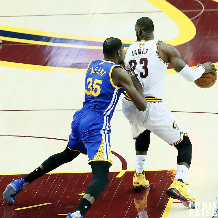 09 June 2017: Golden State Warriors forward Kevin Durant (35) defends on Cleveland Cavaliers forward LeBron James (23) during the Cleveland Cavaliers 137-11 victory over the Golden State Warriors, in game 4 of the 2017 NBA Finals, at  the Quicken Loans Arena, Cleveland, Ohio, USA.