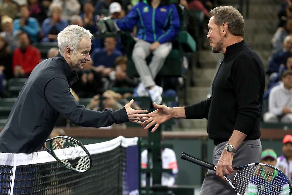 March 1, 2014, Indian Wells, California: <br /> John McEnroe and BNP Paribas Open Tournament Owner Larry Ellison shake hands after warming up during the opening ceremonies for the newly constructed Stadium 2 at the Indian Wells Tennis Garden before the McEnroe Challenge for Charity presented by Esurance.<br /> (Photo by Billie Weiss/BNP Paribas Open)