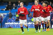 Wayne Rooney of Manchester United leads his team in the warm up during the Barclays Premier League match between Chelsea and Manchester United at Stamford Bridge, London, England on 7 February 2016. Photo by Phil Duncan.