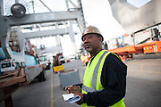 Work begins at the Georgia Ports Authority Garden City Terminal, Saturday, July, 5, 2014, in Savannah, Ga.  (GPA Photo/Stephen B. Morton)
