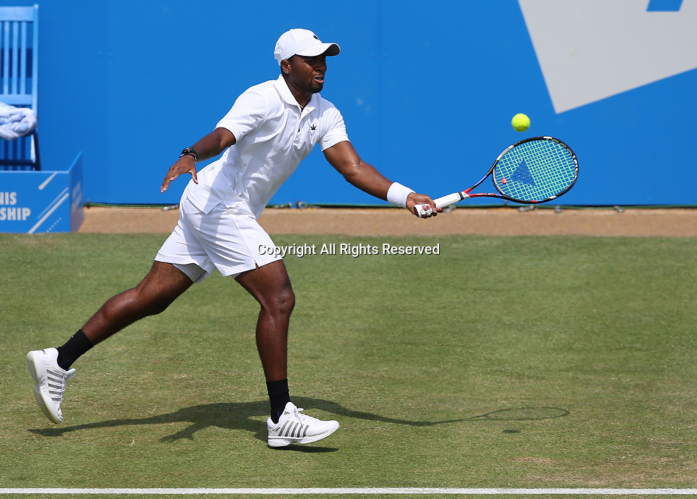 June 21st 2017, Queens Club, West Kensington, London; Aegon Tennis Championships, Day 3; Donald Young of USA with a volley versus Viktor Troicki of Serbia