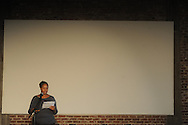 """Samantha Corbell reads during the Yoknapatawpha Arts Council's """"Art For Everyone"""" fundraiser in Oxford, Miss. on Tuesday, October 18, 2011."""