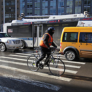 A bicyclist rides in the Manhattan borough of New York on Thursday, Jan. 23, 2014. A recent snow storm created by a polar vortex, dumped almost a foot of snow in some areas of New York City, followed by bitter cold. The NFL plans on featuring the Super Bowl at MetLife stadium in New Jersey on February 3rd amid growing concerns about more snow and bitter cold arriving just prior to the game.  (AP Photo/Alex Menendez)