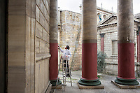 """ROME, ITALY - 30 MARCH 2015: A maintenance worker employed at Cinecittà Studios paints a Roman temple of the set of """"Rome"""", the British-American-Italian broadcasted between 2005 and 2007 on HBO, BBC Two and RaiDue, here in Cinecittà, Rome, Italy, on March 30th 2015.<br /> <br /> Italy instated a special 25% tax credit for film productions in 2010. The industry then lobbied to remove the credit's cap, and last July, Italy lifted its tax credit limit from €5 million per movie to €10 million per company per year. <br />  <br /> Cinecittà, a large film studio in Rome, is considered the hub of Italian cinema. The studios were founded in 1937 by Benito Mussolini as part of a scheme to revive the Italian film industry. In the 1950s, the number of international productions being made here led to Rome being dubbed as the """"Hollywood on the Tiber"""". In the 1950s, Cinecittà was the filming location for several large American film productions like Ben-Hur, and then became the studio most closely associated with Federico Fellini.<br /> After a period of near-bankruptcy, the Italian Government privatized Cinecittà in 1997, selling an 80% stake.<br /> <br /> Currently Ben-Hur and Zoolander 2 are booked into Cinecittà Studios."""