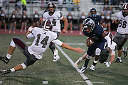 Eastridge quarterback Bobby Albritton makes a move to lose Greece Arcadia defender Justin Hammond (right) during a game at Eastridge High School on Friday, September 2, 2016.