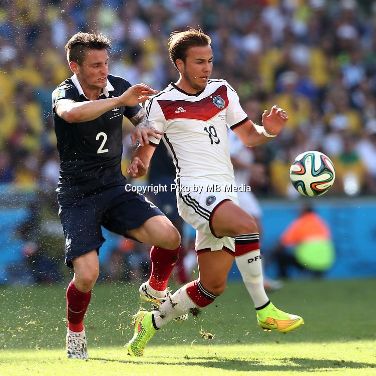 Fifa Soccer World Cup - Brazil 2014 - <br /> FRANCE (FRA) Vs. GERMANY (GER) - Quarter-finals - Estadio do Maracana Rio De Janeiro -- Brazil (BRA) - 04 July 2014 <br /> Here French player Mathieu DEBUCHY (L) and German player Mario GOETZE (R)<br /> &copy; PikoPress