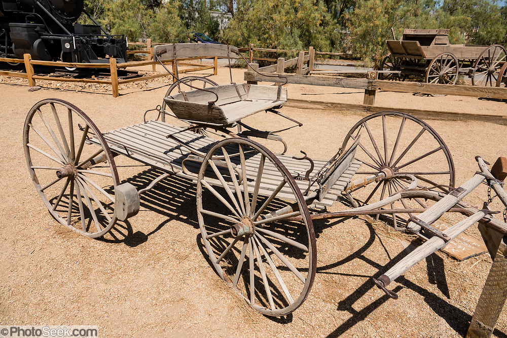 """Borax Smith's 1885 buckboard (four-wheeled wagon) was used on trips from Mojave to Death Valley via Wingate Pass. See historical mining and transportation equipment at the Borax Museum at Furnace Creek Ranch, in Death Valley National Park, California, USA. The oldest house in Death Valley was built in 1883 by F.M. """"Borax"""" Smith in Twenty Mule Team Canyon, then moved here by his Pacific Coast Borax Company in 1954 to serve as a museum."""