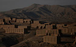 A view of clusters of 'chunche', an Uighur word for drying houses used to dry grapes into raisins by ethnic Uighur grape farmers in Turpan, Xinjiang Uighur Autonomous Province, China, 17 November 2017. Uighurs, a Muslim ethnic minority group in China, make up about 40 per cent of the 21.8 million people in Xinjiang, a vast, ethnically divided region that borders Pakistan, Afghanistan, Kazakhstan, Kyrgyzstan and Mongolia. Other ethnic minorities living in here include the Han Chinese, Kyrgyz, Mongolian and Tajiks people. Xinjiang has long been subjected to separatists unrests and violent terrorist attacks blamed by authorities on Islamist extremism while human rights groups say Chinese repression on religious rights, culture and freedom of movement caused undue tensions. Life however goes on under the watchful eye of the government for the ethnic Uighurs living in the city of Urumqi and surrounding areas and the region is still considered an attractive tourist spot. A recent report by state media Xinhua news agency claims Xinjiang received more than 100 million tourists in 2017, 'the highest figure in its history'.