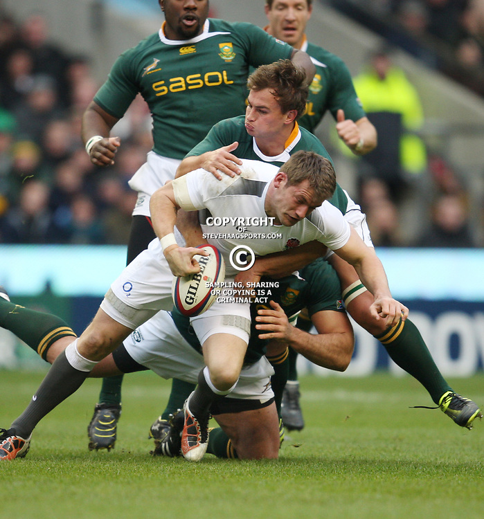 LONDON, ENGLAND - NOVEMBER 27,Mark Cueto tackled by Deon Stegmann  during the End of Year tour match between England and South Africa at Twickenham Stadium on November 27, 2010 in London, England<br /> Photo by Steve Haag / Gallo Images