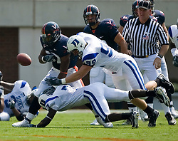 Duke defensive end Wesley Oglesby (99) knocks the ball away from Virginia running back Cedric Peerman (37).  The Virginia Cavaliers defeated the Duke Blue Devils 23-14 at Scott Stadium in Charlottesville, VA on September 8, 2007  With the loss, Duke extended their longest-in-the-nation losing streak to 22 games.