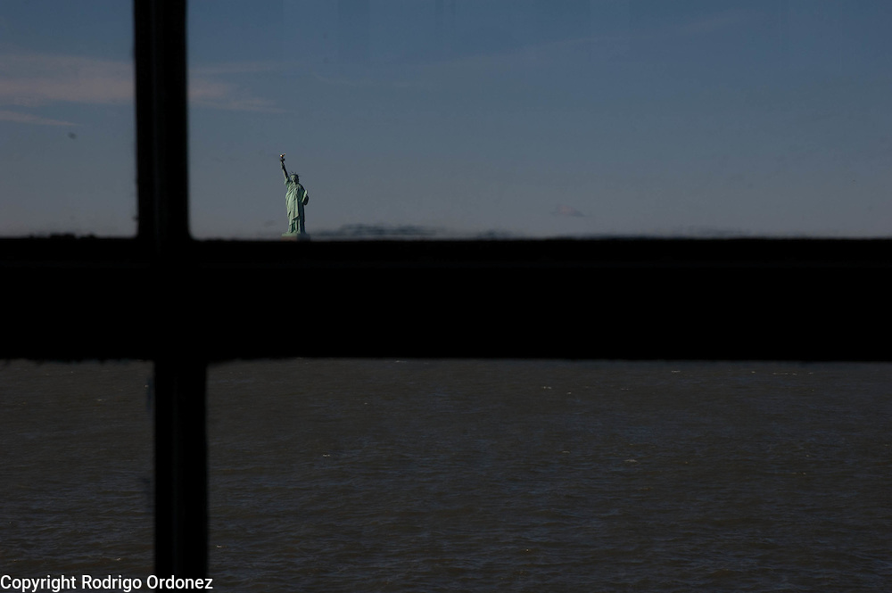 View of the Statue of Liberty through a window of the Staten Island Ferry.