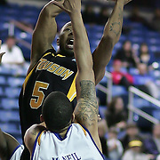 (#5) RaShawn Polk drives to the hoop during Towson Delaware game. Delaware defeated Towson 80-70 at The Bob Carpenter Center Wednesday night In Newark Delaware.