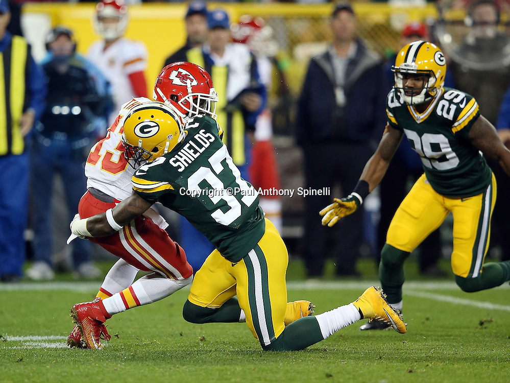 Green Bay Packers cornerback Casey Hayward (29) looks on as Green Bay Packers cornerback Sam Shields (37) puts a big hit on Kansas City Chiefs wide receiver De'Anthony Thomas (13) on a second quarter play during the 2015 NFL week 3 regular season football game against the Kansas City Chiefs on Monday, Sept. 28, 2015 in Green Bay, Wis. The Packers won the game 38-28. (©Paul Anthony Spinelli)