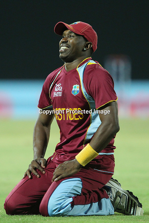 Dwayne Bravo of The West Indies reacts after missing a catch opportunity during the ICC World Twenty20 Super 8s match between Sri Lanka and The West Indies held at the  Pallekele Stadium in Kandy, Sri Lanka on the 29th September 2012<br /> <br /> Photo by Ron Gaunt/SPORTZPICS