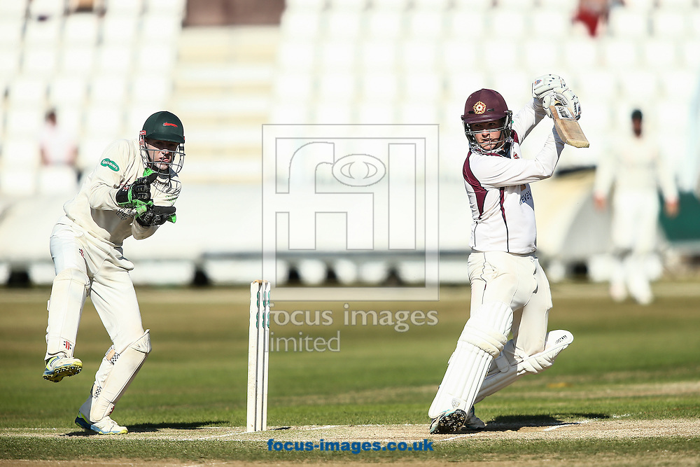 Rob Newton of Northamptonshire CCC (right)  drives as Niall O'Brien of Leicestershire (left)  looks on during the Specsavers County C'ship Div Two match at the County Ground, Northampton<br /> Picture by Andy Kearns/Focus Images Ltd 0781 864 4264<br /> 15/08/2016