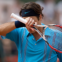 05 June 2007: Swiss player Roger Federer is seen during the French Tennis Open quarter final match won 7-5, 1-6, 6-1, 6-2 by Roger Federer over Tommy Robredo on day 10 at Roland Garros, in Paris, France.