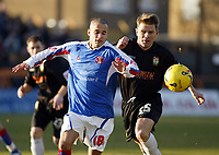 Photo: Chris Ratcliffe.<br />Barnet FC v Carlisle United. Coca Cola League 2. 25/02/2006.<br />Simon Hackney (L) of Carlisle tussles with Andy Hessenthaler of Barnet.
