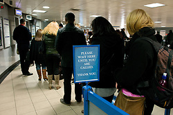 Ticket Office Job Cuts. Passengers queue at Euston ticket station. London Underground will run weekend services 24 hours under plans that also involve ticket office closures and up to 750 job cuts.Euston Station, London, United Kingdom. Thursday, 21st November 2013. Picture by Peter Kollanyi / i-Images
