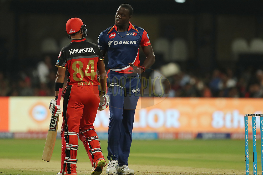 Carlos Brathwaite of the Delhi Daredevils and Stuart Binny of the Royal Challengers Bangalore share a lighter moment during match 5 of the Vivo 2017 Indian Premier League between the Royal Challengers Bangalore and the Delhi Daredevils held at the M.Chinnaswamy Stadium in Bangalore, India on the 8th April 2017<br /> <br /> Photo by Ron Gaunt - IPL - Sportzpics