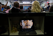 A laptop displays a picture of former Presdient Barack Obama crying as White House Press Secretary Sean Spicer holds the daily press briefing at the White House.