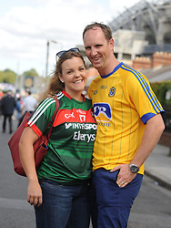 Recently married Mayo supporter Aine Staunton from Tourmakeady with husband Sean Kelly from Athloneon their way to the Croke park for the All Ireland quarter final replay<br /> Pic Conor McKeown