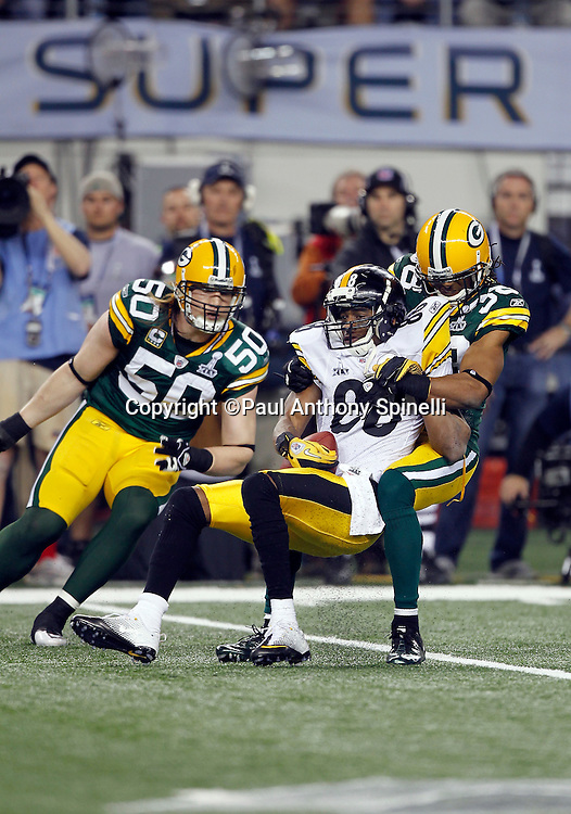 Pittsburgh Steelers wide receiver Emmanuel Sanders (88) catches a second quarter pass good for a first down while getting tackled by Green Bay Packers cornerback Tramon Williams (38) during Super Bowl XLV against the Green Bay Packers on Sunday, February 6, 2011, in Arlington, Texas. The Packers won the game 31-25. ©Paul Anthony Spinelli
