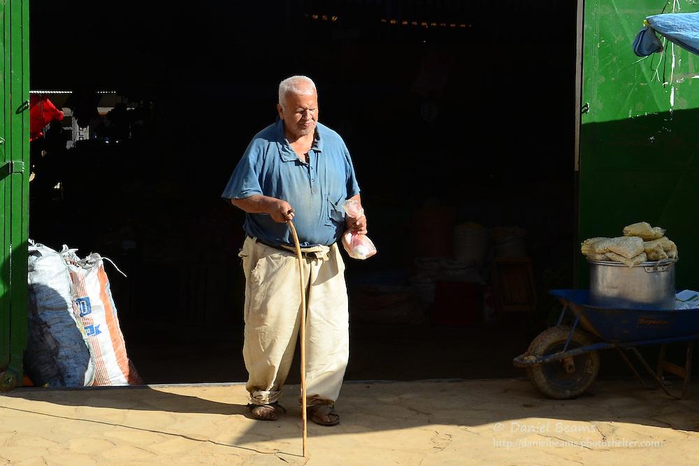 Blind man leaving a market in Samaipata, Santa Cruz, Bolivia