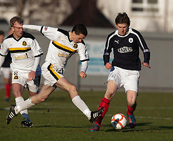 Dumbarton's PaulMcGinn and Falkirk's Blair Alston..Dumbarton 0 v 2 Falkirk, 23/2/2013..©Michael Schofield.