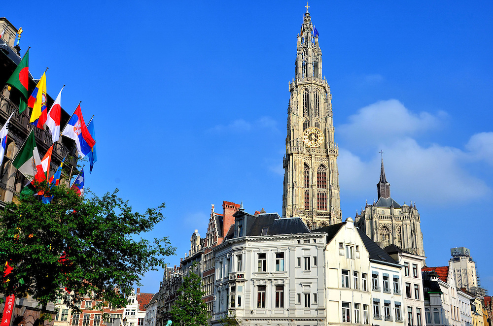 Old Town of Antwerp, Belgium <br /> This view is typical of the charm of the Old Town of Antwerpen in northern Belgium.  On the left is the colorful City Hall called Stadhuis. In the middle is the clock spire of Cathedral of Our Lady. With its population of about a half million, Antwerpen is most famous as the &ldquo;diamond capital of the world.&rdquo;  In addition, 20,000 of its citizens work in the fashion industry. Antwerp has been developing an excellent reputation since the mid-1990s.