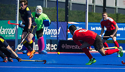 Holcombe's Stephane Vehrle-Smith scores against Team Bath Buccaneers. Holcombe v Team Bath Buccaneers - Now: Pensions Finals Weekend, Lee Valley Hockey & Tennis Centre, London, UK on 12 April 2015. Photo: Simon Parker