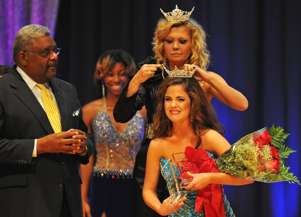 Grace Claire Cordes of Vicksburg, Miss. is crowned as Miss University of Southern Mississippi 2012 by Miss Southern Miss 2011 Jill Duckworth while Dean of Student Eddie Holloway, left, looks on during the pageant Saturday at Bennett Auditorium. Bryant Hawkins/ Hattiesburg American