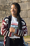 A young lady travelling in Japan visiting Nagoya Castle.