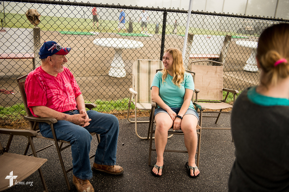 Joanna Johnson, new GEO missionary to Taiwan, chats with church member Doug Travis as they host a fundraiser for a short-term parish mission trip to Alaska at the Hampton Heights Golf Club on Saturday, April 22, 2017, in Hickory, N.C. LCMS Communications/Erik M. Lunsford