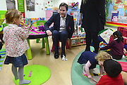 © Licensed to London News Pictures. 13/11/2012. London, UK Nick Clegg sits on a child's chair whilst visiting the Nursery. Deputy Prime Minister Nick Clegg visits the 'Third Door', in Putney today Putney today, 13 November 2012. An innovative centre combining a workspace for parents and childcare for their children, parents can drop off their children in the nursery, and hire a working space including desk, meeting room and facilities.  He announced new flexible parental leave for parents, mothers and fathers can now share the maternity leave allowance.. Photo credit : Stephen Simpson/LNP