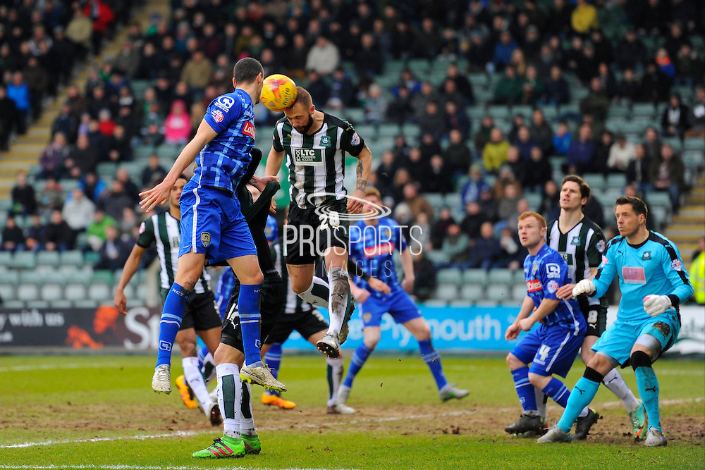 Plymouth Argyle's Jordon Forster heads the ball in his penalty area to clear the danger during the Sky Bet League 2 match between Plymouth Argyle and Notts County at Home Park, Plymouth, England on 27 February 2016. Photo by Graham Hunt.