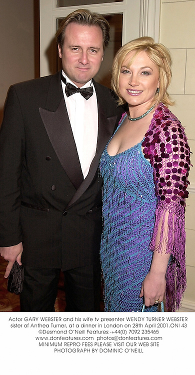 Actor GARY WEBSTER and his wife tv presenter WENDY TURNER WEBSTER sister of Anthea Turner, at a dinner in London on 28th April 2001.ONI 43