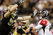 NEW ORLEANS, LA - DECEMBER 26:   Matt Ryan #2 of the Atlanta Falcons throws a pass under pressure from Jeff Charleston #97 of the New Orleans Saints at Mercedes-Benz Superdome on December 26, 2011 in New Orleans, Louisiana.  The Saints defeated the Falcons 45-16.  (Photo by Wesley Hitt/Getty Images) *** Local Caption *** Matt Ryan; Jeff Charleston
