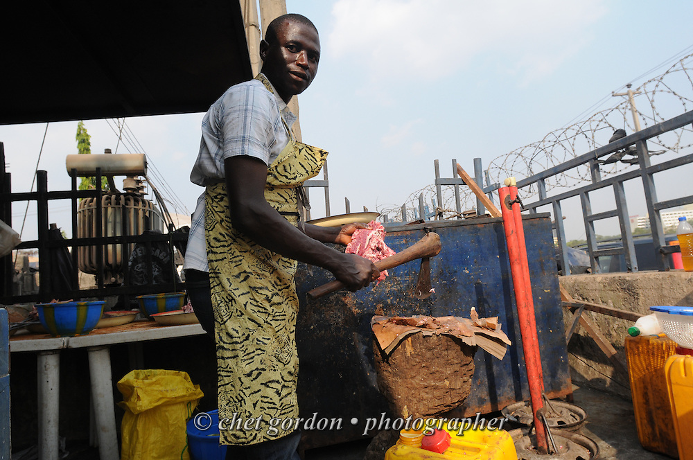 A Nigerian butcher cooks roasted beef in Abuja, Nigeria on Saturday, December 8, 2012.