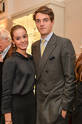 VISCOUNT ERLEIGH and OLIVIA CALLAGHAN at a preview of the latest collections by jewellery designer Kiki Mcdonough and fashion label Beulah held at Kiki McDonough Jewellery, 12 Symons Street, London on 5th March 2014.