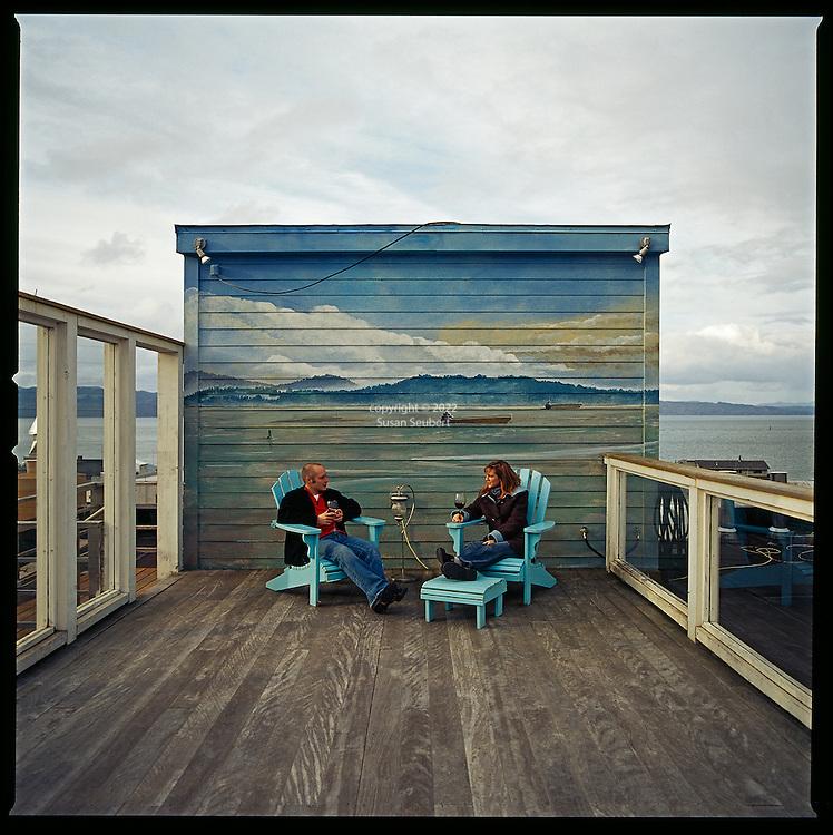 A couple enjoying wine on the Hotel Elliott's rooftop terrace, Astoria, Oregon